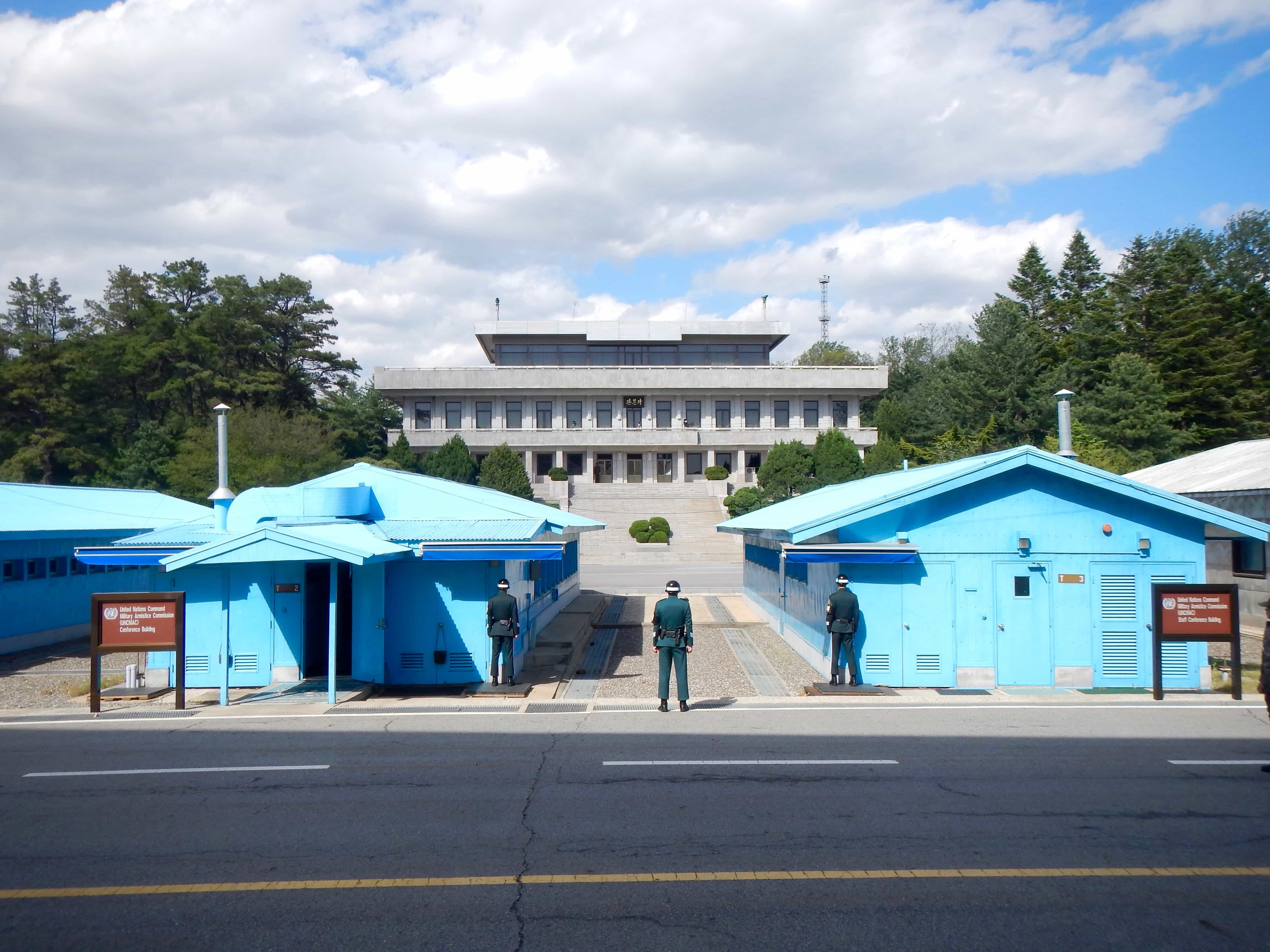 One Korea. One History. One Language. Divided by ideology. When visiting Seoul, be sure to visit the JSA. Would you dare to step foot into North Korea? Read more at www.thefivefoottraveler.com
