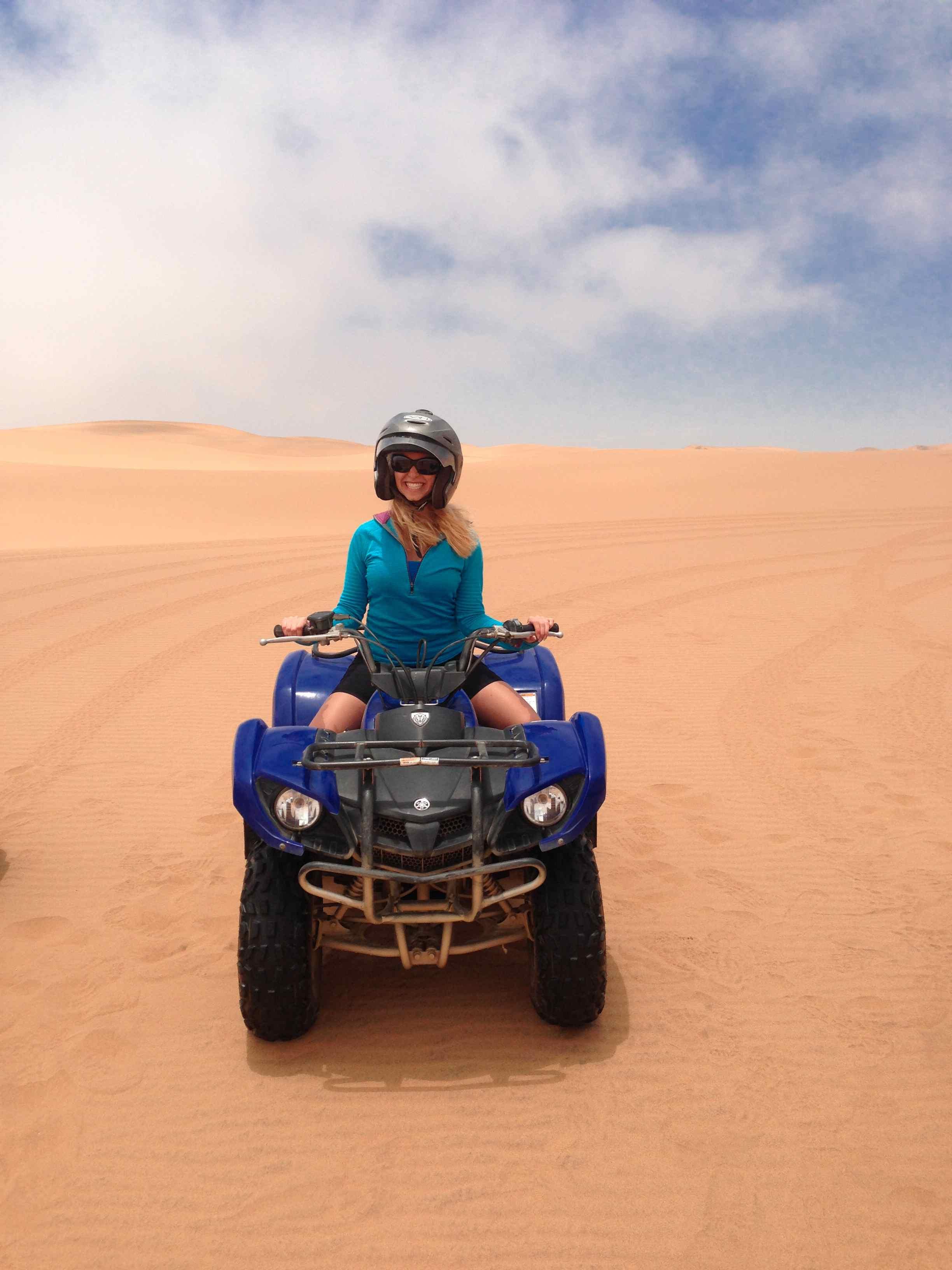 girl on blue atv in the namib desert