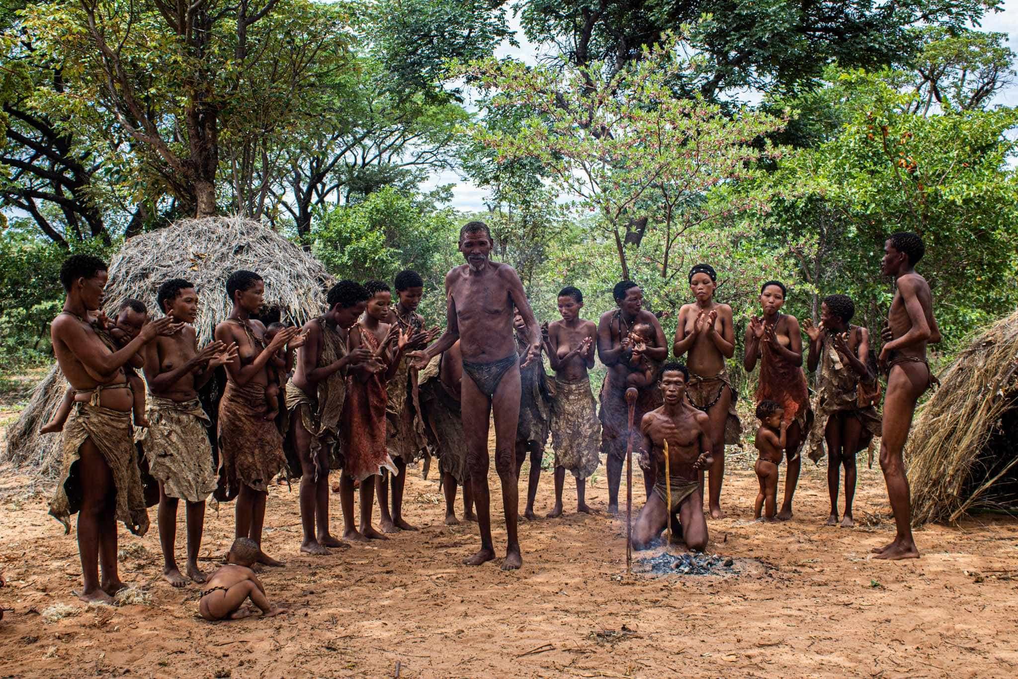the san bushmen gather for a healing dance wearing traditional clothing