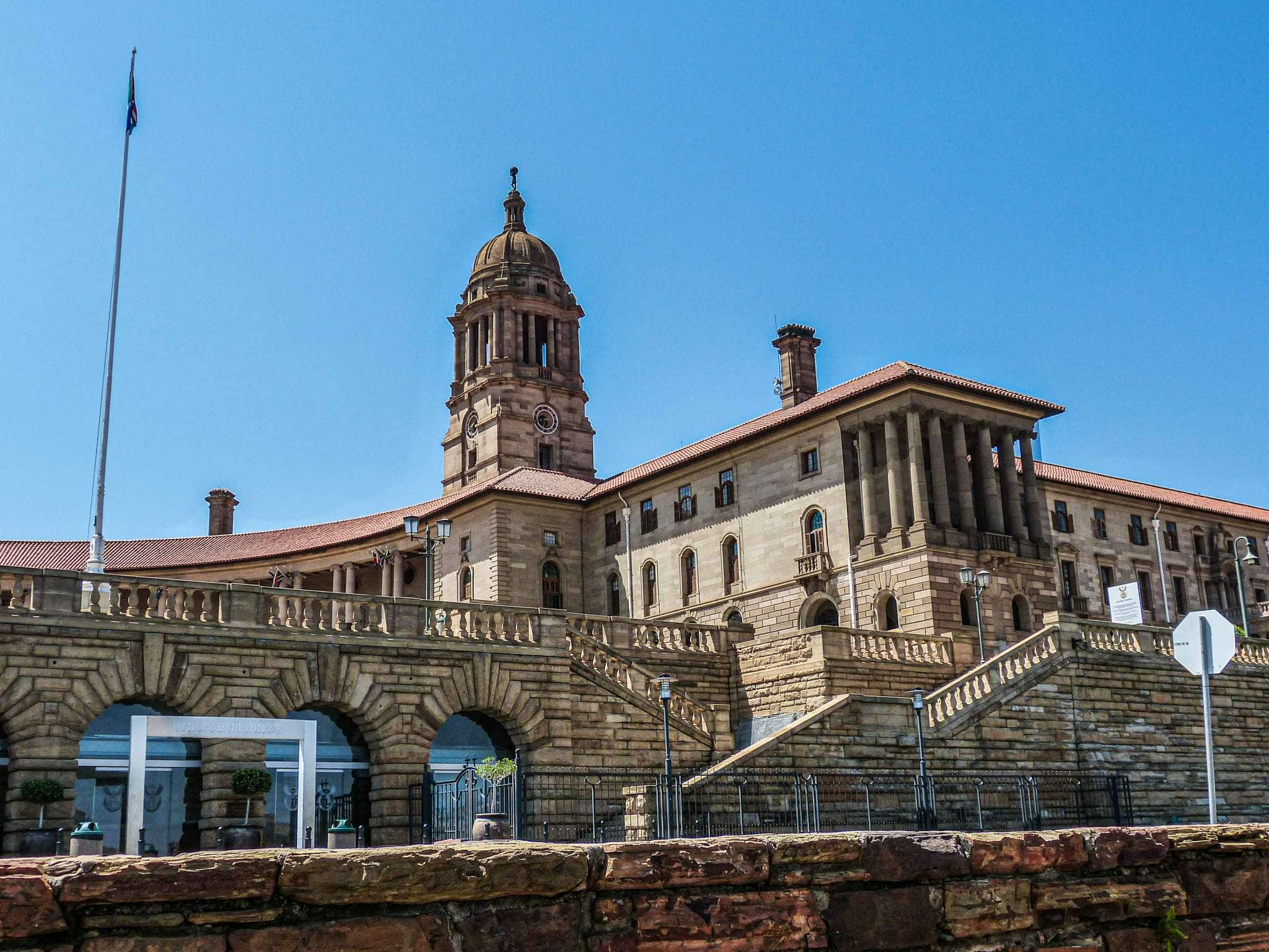a brown administrative building in pretoria, south africa; pretoria is worth a quick stop on your South Africa vacation