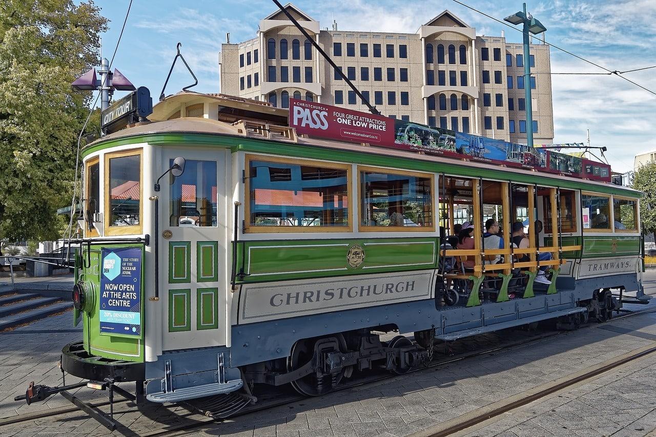 green tram in the street