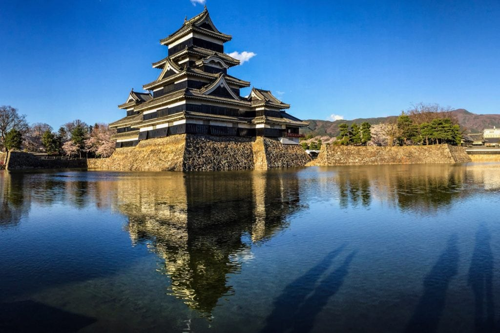 matsumoto castle in japan reflected in the moat - places to visit in japan
