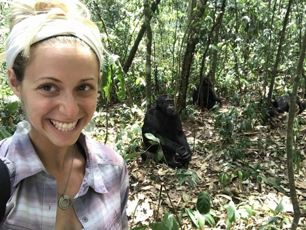girl taking a selfie with a chimp