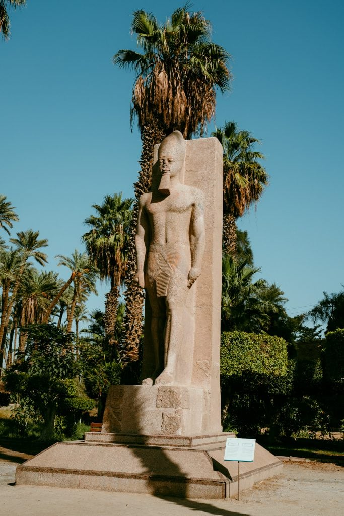 a small statue of ramses II in memphis - a stop of the egypt pyramids tour
