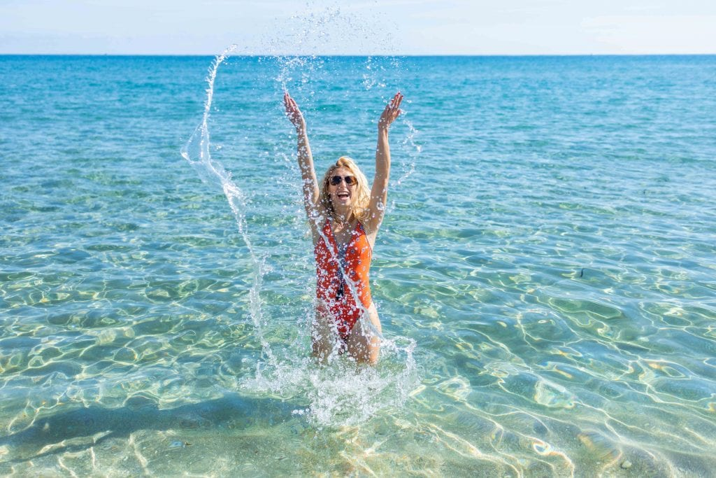 girl splashes in water at delray beach