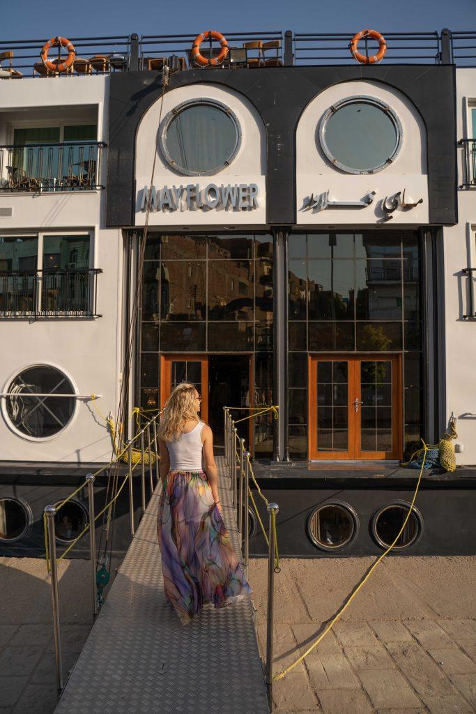 girl walks onto the M.S. Mayflower - the best nile cruise