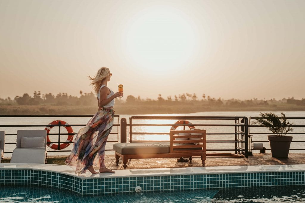 girls relaxes on the sundeck overlooking the Nile