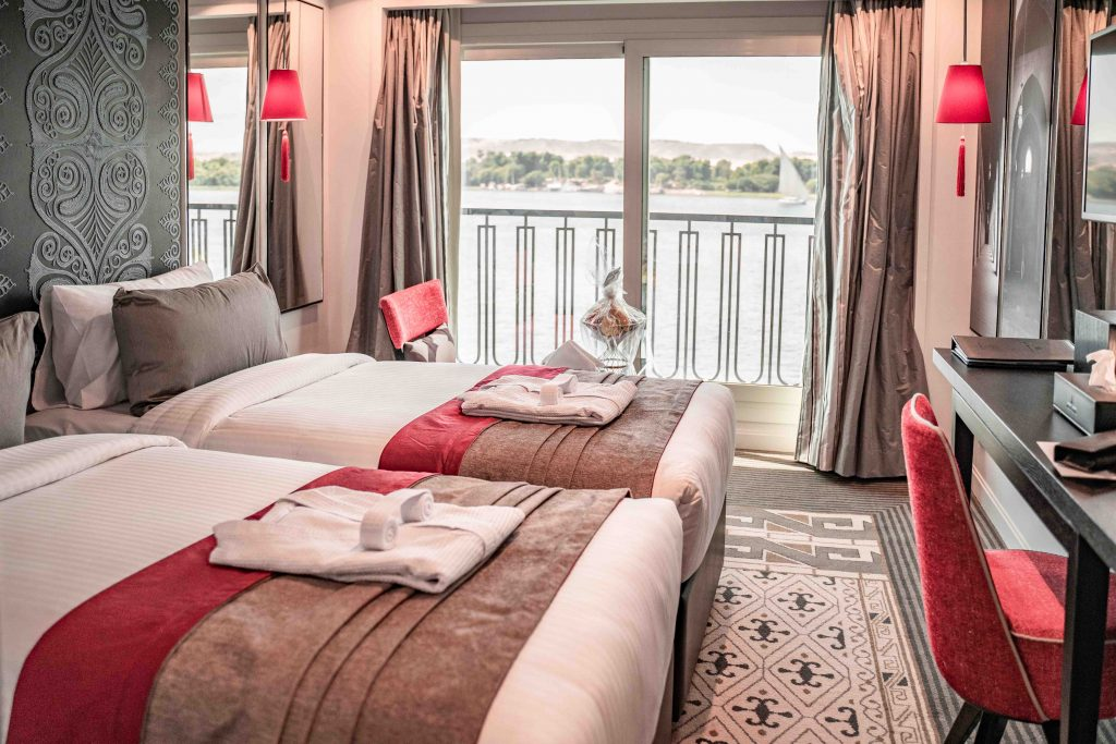 two twin beds in a standard cabin overlook the nile
