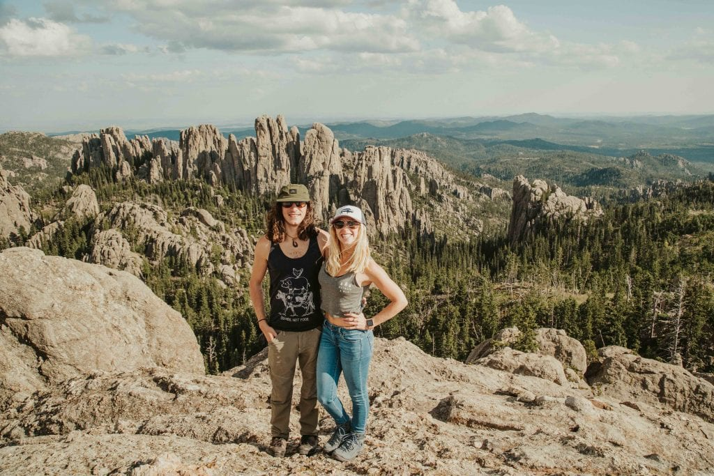 brother and sister overlook the cathedral spires in custer state park