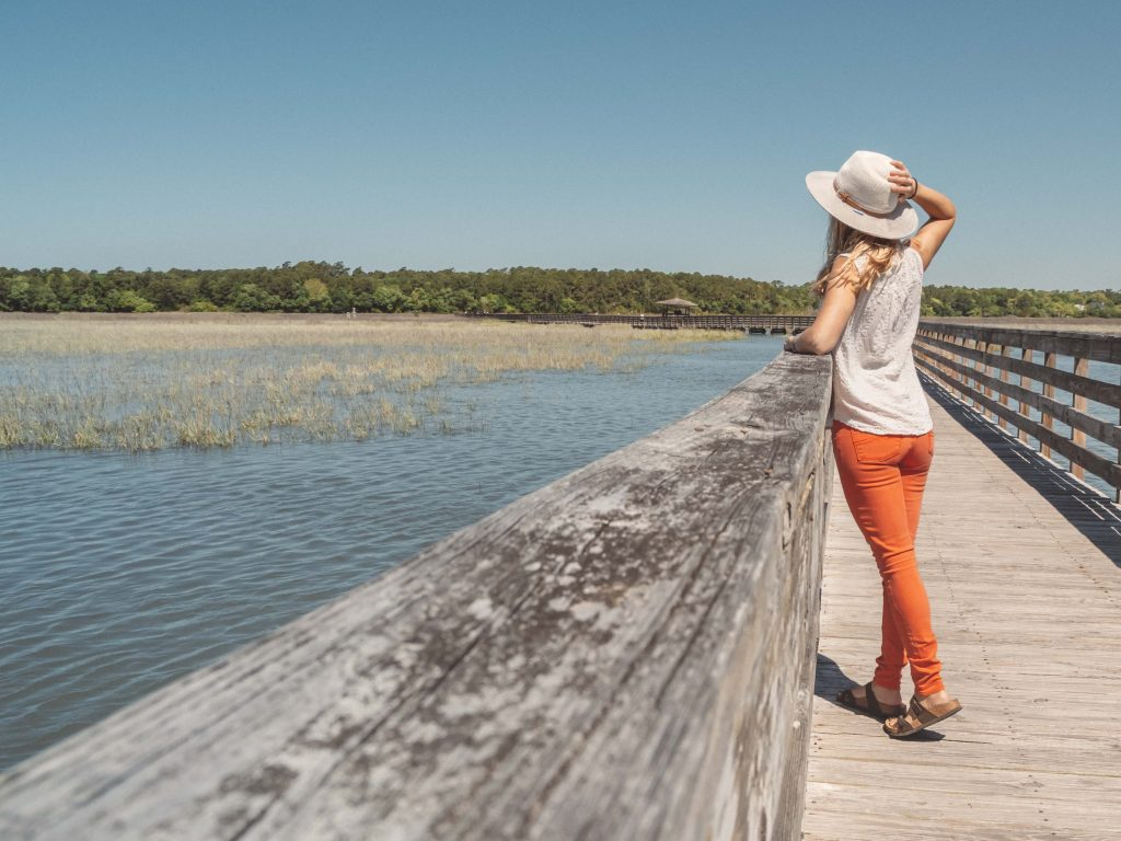 a girl stands at a nature overlook in Huntington Beach State Park in Myrtle Beach