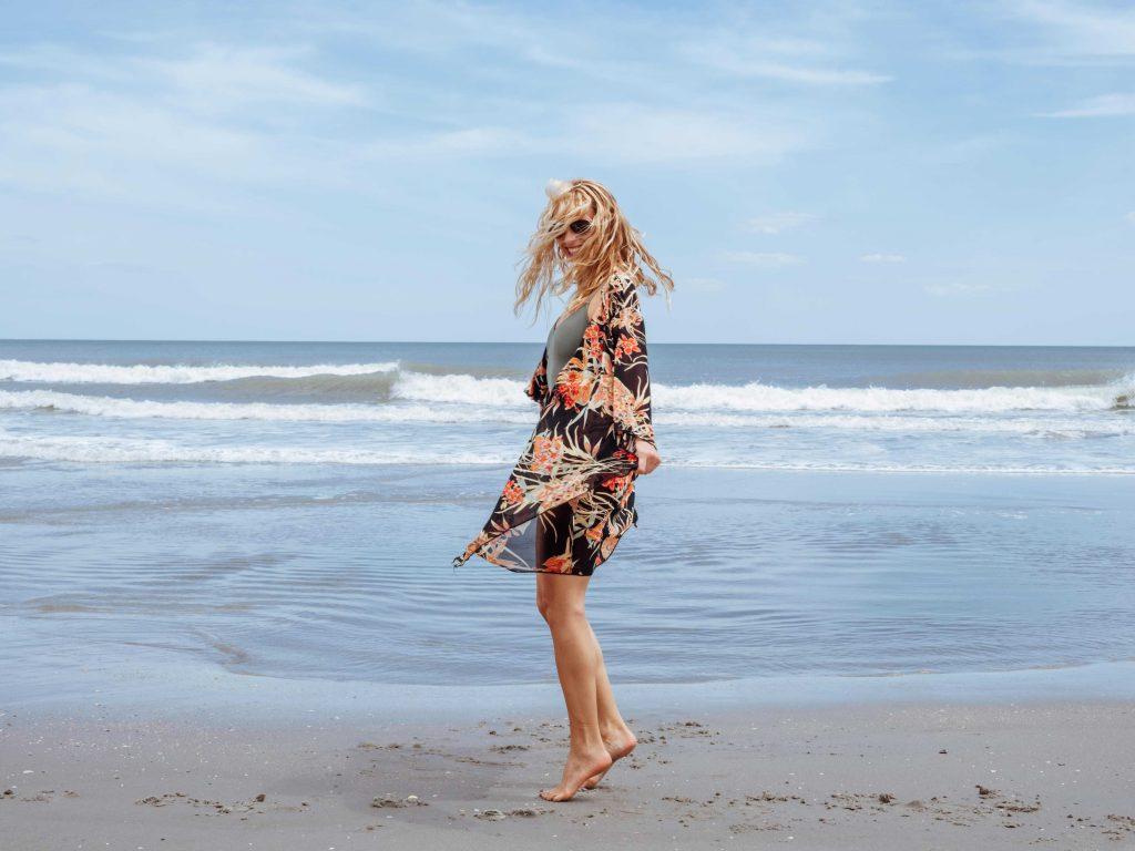 girl dances in the sand on myrtle beach