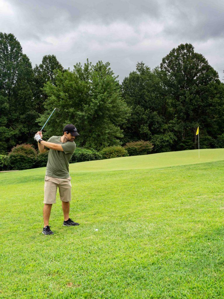 a man golfs in west virginia